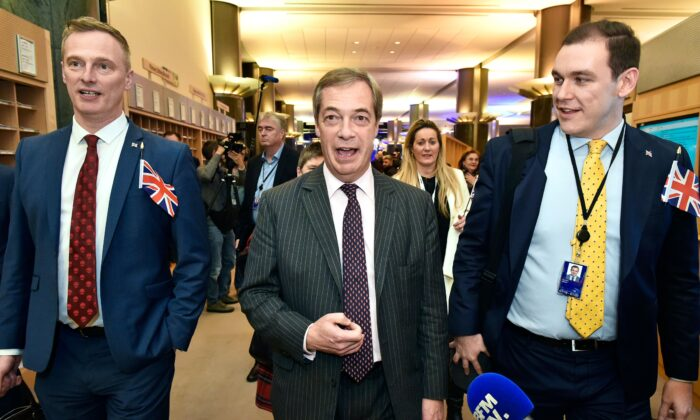 Britain's Brexit Party leader Nigel Farage (C) speaks to the press after the European Parliament ratified the Brexit deal in Brussels on Jan. 29, 2020. (JOHN THYS/AFP via Getty Images)
