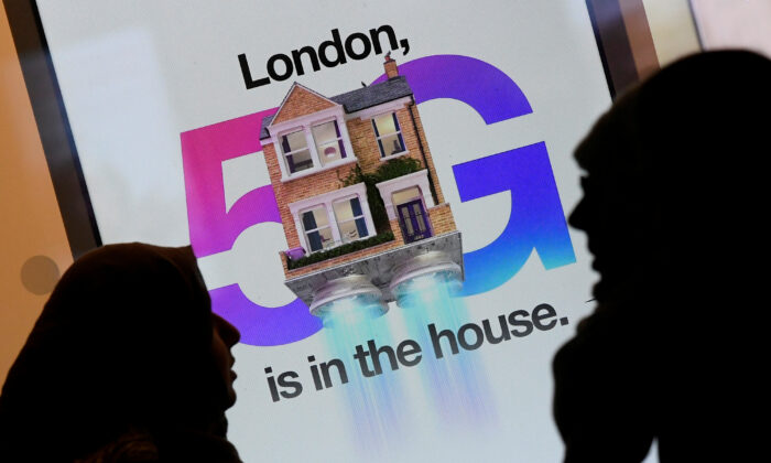 Pedestrians walk past an advertisement promoting the 5G data network at a mobile phone store in London, Britain, on Jan. 28, 2020. (Toby Melville/Reuters)