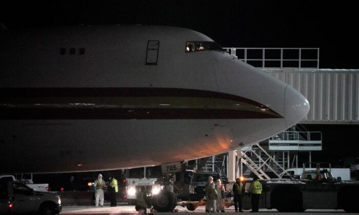 An aircraft chartered by the U.S. State Department to evacuate government employees and other Americans from the novel coronavirus threat in the Chinese city of Wuhan, is seen on the tarmac after arriving at a closed terminal at Ted Stevens Anchorage International Airport in Anchorage, Alaska on Jan. 28, 2020. (Kerry Tasker/Reuters)