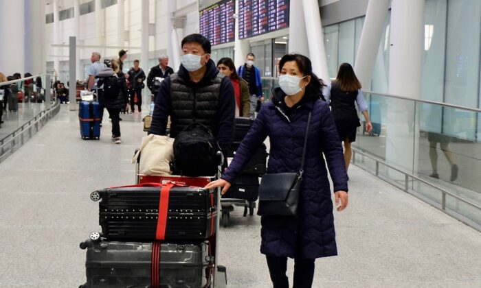 Passengers arrive at Toronto Pearson Airport on a flight from Beijing on Jan. 25, 2020. (Becky Zhou/The Epoch Times)