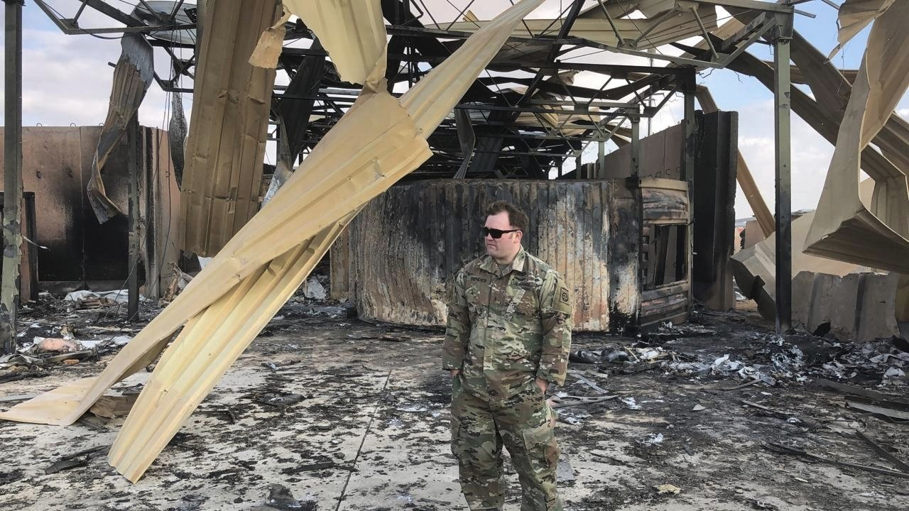 soldier stands at a site of Iranian bombing