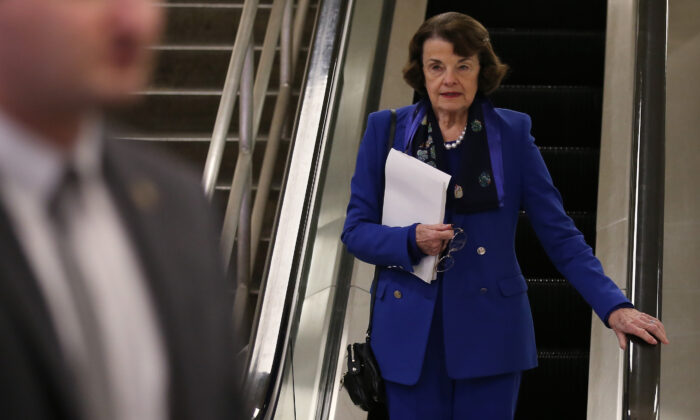 Sen. Dianne Feinstein (D-Calif.) descends an escalator at the U.S. Capitol after the Senate impeachment trial adjourned for the day in Washington on Jan. 28, 2020. (Mario Tama/Getty Images)