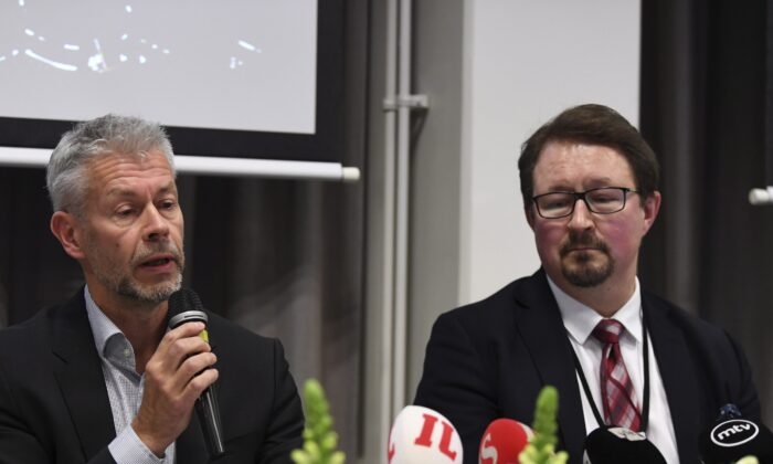 Chief Physician Taneli Puumalainen (L) and Director Mika Salminen of THL (National Institute for Health and Welfare) announce the first confirmed coronavirus case in Finland on Jan. 29, 2020. (Antti Aimo-Koivisto/AFP via Getty Images)