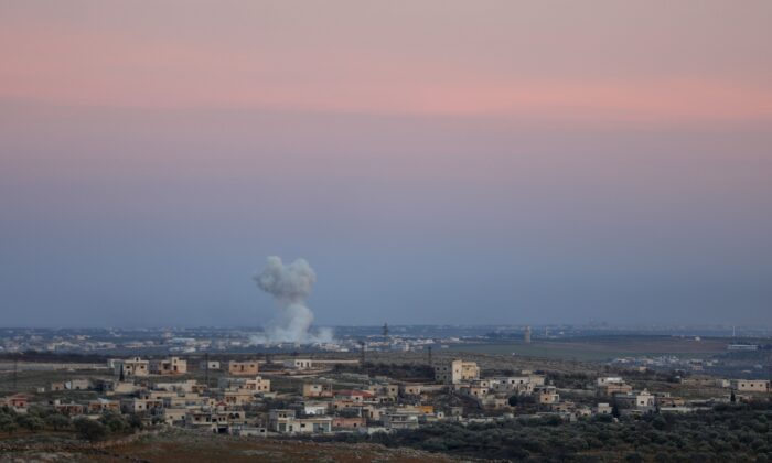 Smoke billows following reported bombardment by Syrian regime forces on the outskirts of Maaret al-Numan, in the northwestern Syrian province of Idlib, on Jan. 26, 2020. (Omar Has Kadour/AFP via Getty Images)