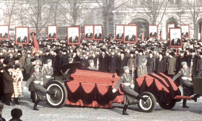 """The coffin containing the remains of Yuri Andropov, former KGB chief and Soviet premier, is pulled through Moscow streets during his funeral on Feb. 13, 1984. Andropov called the Soviets' strategy of ideological subversion in the West """"the final struggle for the minds and hearts of the people."""" (AFP via Getty Images)"""