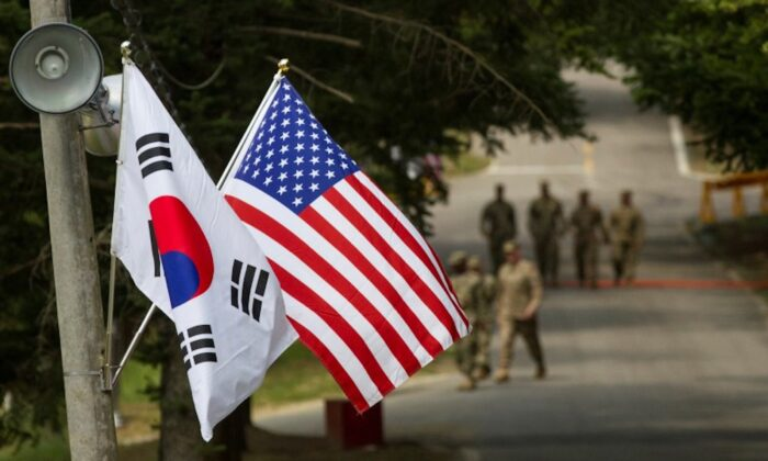 The South Korean and American flags fly next to each other at Yongin, South Korea, on Aug. 23, 2016. (Ken Scar/U.S. Army/Handout via Reuters)