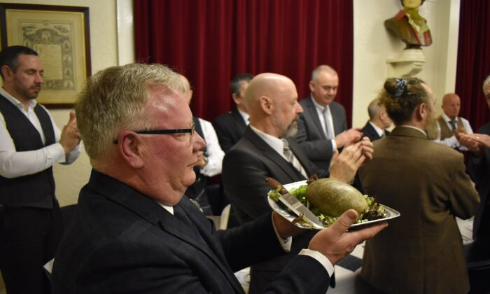 A haggis being brought in at Burns Club's in Dundee, Scotland, for the 160th annual Burns supper on 25 Jan. 25, 2020. (CC BY-SA 4.0)
