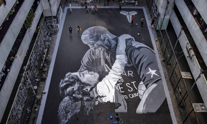 A giant mural of former NBA star Kobe Bryant and his daughter Gianna, painted hours after their death, is seen at a basketball court in Taguig, Metro Manila, Philippines, on Jan. 28, 2020.  (Ezra Acayan/Getty Images)