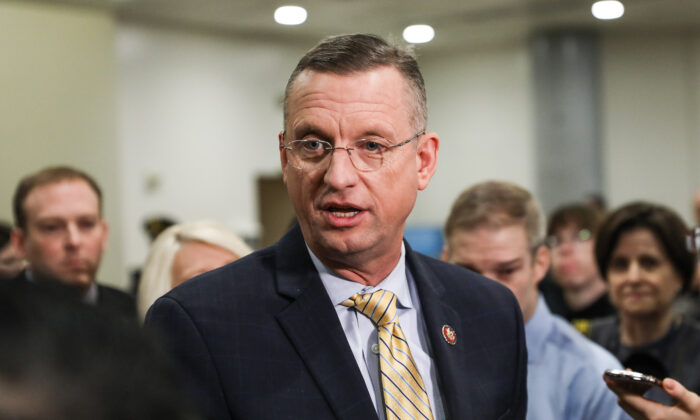 Rep. Doug Collins (R-Ga.) speaks to media while other impeachment defense team advisors look on, at the Capitol in Washington on Jan. 27, 2020. (Charlotte Cuthbertson/The Epoch Times)