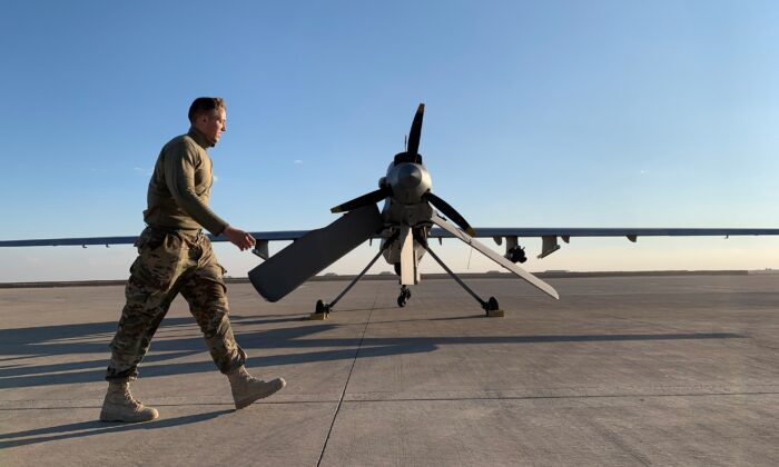 A member the U.S. forces walks past a drone in the Ain al-Asad airbase in the western Iraqi province of Anbar on Jan. 13, 2020.(Ayman Henna/AFP via Getty Images)