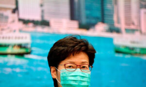 Hong Kong Leader Rejects Calls to Close Border Despite Virus Fears