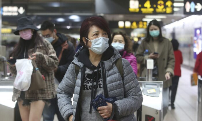 People wear masks at a metro station in Taipei, Taiwan, on Jan. 28, 2020. According to the Taiwan Centers of Disease Control, the eighth case diagnosed with the novel coronavirus has been confirmed in Taiwan. (AP Photo/Chiang Ying-ying)