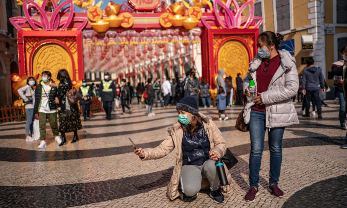 People wearing face masks take a selfie in Macau, China, on Jan. 28, 2020. (Anthony Kwan/Getty Images)