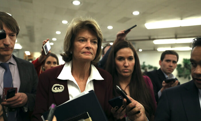 Sen. Lisa Murkowski (R-Alaska) walks through the Senate subway area during a break in impeachment proceedings, in the Capitol in Washington on Jan. 28, 2020. (Charlotte Cuthbertson/The Epoch Times)