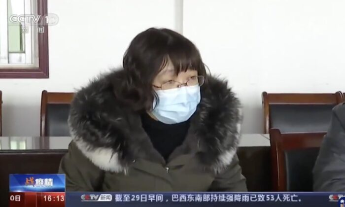 Tang Zhihong, chief of Huanggang health commission, is keeping silent when Beijing experts asked her the epidemic status in Huanggang, China on Jan. 29, 2020. (Screenshot)