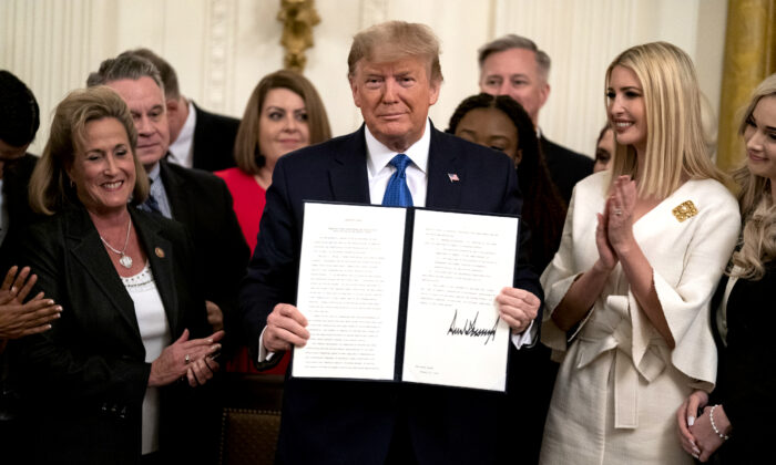 President Donald Trump presents an executive order to help combat human trafficking, in the East Room of the White House in Washington on Jan. 31, 2020. (Evan Vucci/AP Photo)