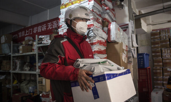 An expressman checks deliveries in an Express station in Wuhan, Hubei Province, China on Jan. 20, 2020. (Stringer/Getty Images)