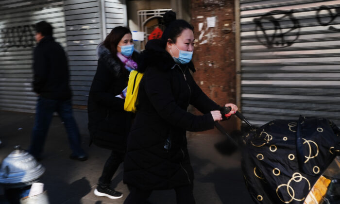 People wear medical face masks on the streets of Chinatown in New York City on Jan. 29, 2020. (Spencer Platt/Getty Images)