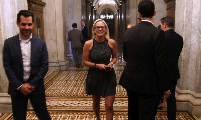 Sen. Kyrsten Sinema (D-Ariz.) walks in the U.S. Capitol in Washington on Aug. 1, 2019. (Mark Wilson/Getty Images)