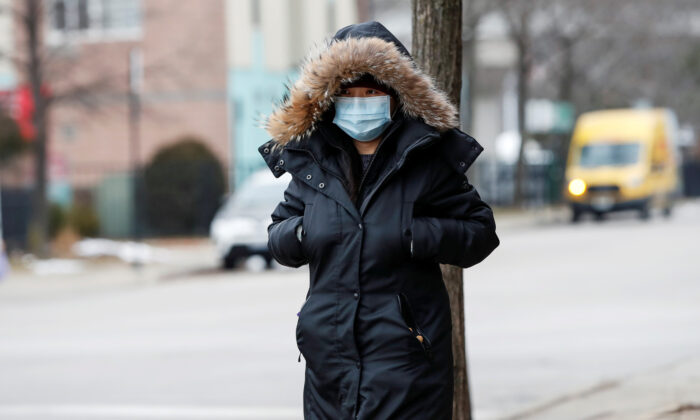 A woman wears a mask in Chinatown following the outbreak of the novel coronavirus, in Chicago, Illinois, U.S. Jan. 30, 2020. (Reuters/Kamil Krzaczynski/File Photo)