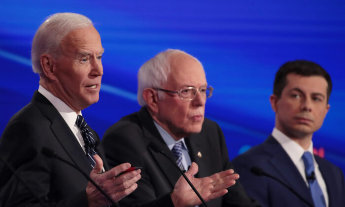 Former Vice President Joe Biden (L) speaks next to Sen. Bernie Sanders (I-Vt.) and former South Bend Mayor Pete Buttigieg at the Democratic presidential primary debate in Des Moines, Iowa, on Jan. 14, 2020. (Scott Olson/Getty Images)