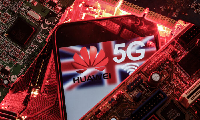 The British flag and a smartphone with a Huawei and 5G network logo are seen on a PC motherboard in this illustration picture taken on Jan. 29, 2020. (Dado Ruvic/Illustration/Reuters)