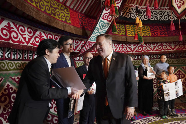 U.S. Secretary of State Mike Pompeo, center, meets with Kazakh citizens who said their family members have been detained in Xinjiang, China, in a yurt at the U.S. Ambassador's residence in Nur-sultan, Kazakhstan, Sunday, Feb. 2, 2020. (Kevin Lamarque/Pool Photo via AP)