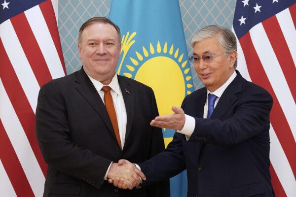 U.S. Secretary of State Mike Pompeo, left, meets Kazakh President Kassym-Jomart Tokayev at the Akorda presidential residence in Nur-Sultan, Kazakhstan, Sunday, Feb. 2, 2020. (Kevin Lamarque/Pool Photo via AP)