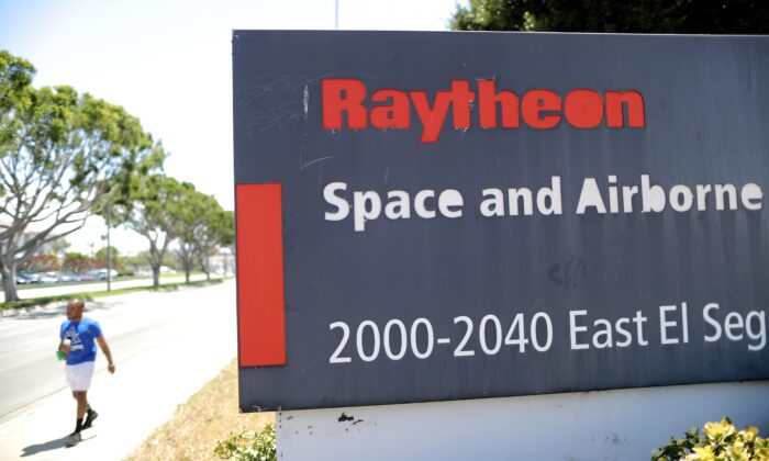 A sign is posted at a Raytheon Co. campus in El Segundo, Calif. on June 10, 2019. A former engineer at Raytheon Missile Systems was indicted on charges of violating U.S. export control laws. (Mario Tama/Getty Images)