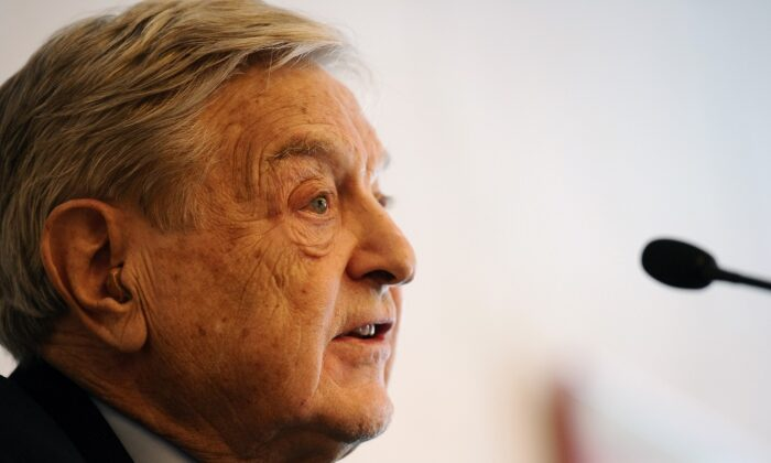 George Soros speaks to the media at the Swiss resort of Davos on Jan. 25, 2012. (VINCENZO PINTO/AFP via Getty Images)