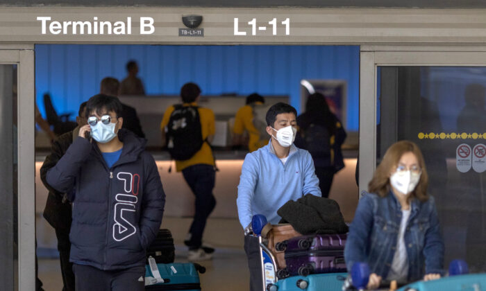 Travelers arrive to LAX Tom Bradley International Terminal wearing medical masks for protection against the novel coronavirus outbreak in Los Angeles, Calif., on Feb. 2, 2020. (David McNew/Getty Images)