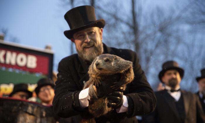 Groundhog Club co-handler Al Dereume holds Punxsutawney Phil, the weather prognosticating groundhog, during the 134th celebration of Groundhog Day on Gobbler's Knob in Punxsutawney, Pa., on Feb. 2, 2020. (Barry Reeger/AP Photo)