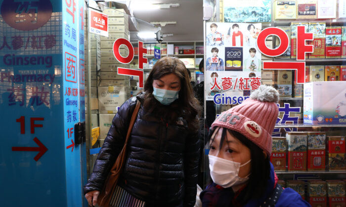 People leave after buying face masks at a pharmacy at Myeongdong shopping district in Seoul, South Korea, on Jan. 31, 2020. (Chung Sung-Jun/Getty Images)