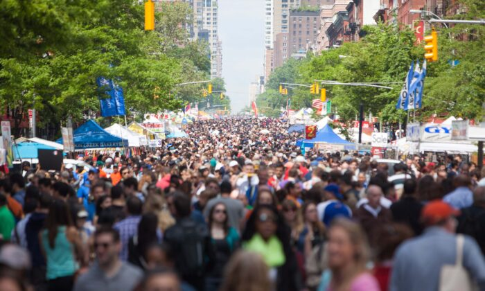 Thousands of people shop at booths at the Ninth Avenue International Food Festival, in New York City, on May 18, 2014.  Petr Svab/The Epoch Times