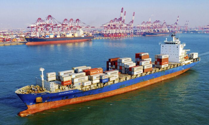 A container vessel moves past the port in Qingdao in eastern China's Shandong Province on Jan. 14, 2020. (Chinatopix Via AP)