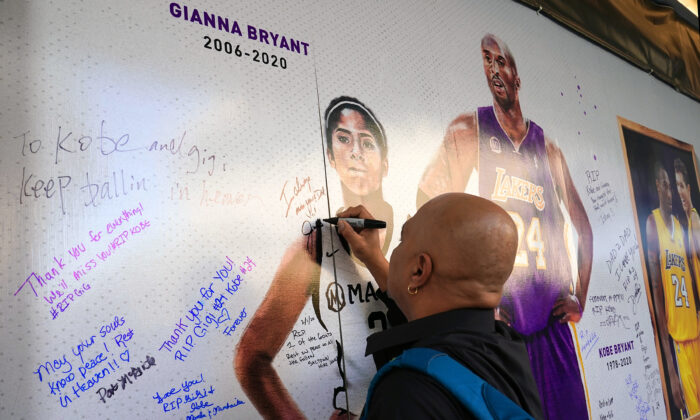 Fans honor Kobe Bryant and his daughter Gianna Bryant at an art installation wall in remembrance of Kobe and Gianna in the plaza across from Golden 1 Center prior to the Los Angeles Lakers Sacramento Kings basket ball game at Golden 1 Center in Sacramento, Calif., on Feb. 1, 2020. (Thearon W. Henderson/Getty Images)