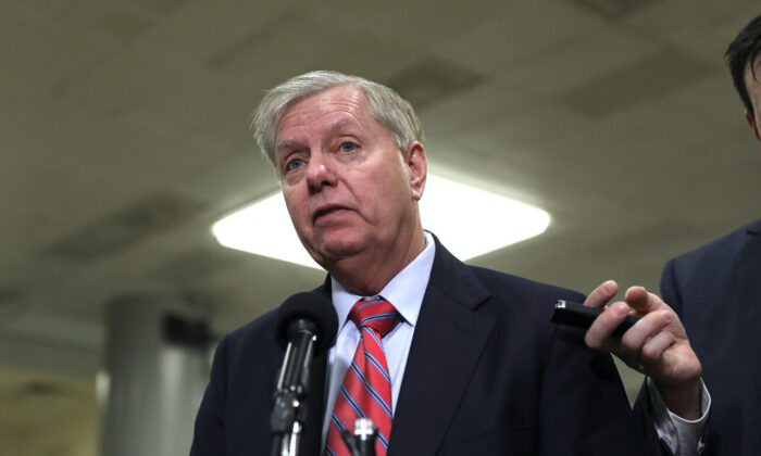 Sen. Lindsey Graham (R-S.C.) speaks to media during a break in impeachment proceedings, in the Senate subway area in the Capitol in Washington on Jan. 28, 2020. (Charlotte Cuthbertson/The Epoch Times)