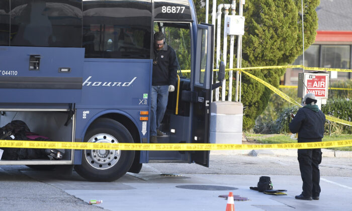 Investigators are seen outside of a Greyhound bus after a passenger was killed on board in Lebec, Calif., on Feb. 3, 2020. (Jayne Kamin-Oncea/AP Photo)