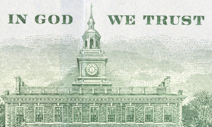 "The back of a 100 dollar banknote that features the national motto ""In God We Trust."" (Shutterstock)"