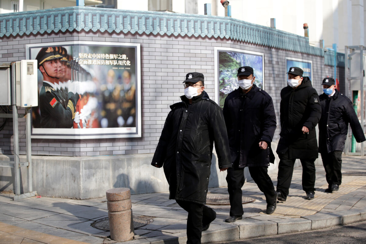 Hong Kong reports first coronavirus death as hospital workers escalate strike