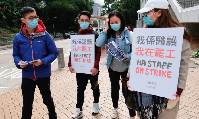 Medical workers hold a strike near Queen Elizabeth Hospital as they demand Hong Kong close its border with China to reduce the coronavirus spreading, in Hong Kong, China, on Feb. 3, 2020. (Tyrone Siu/Reuters)