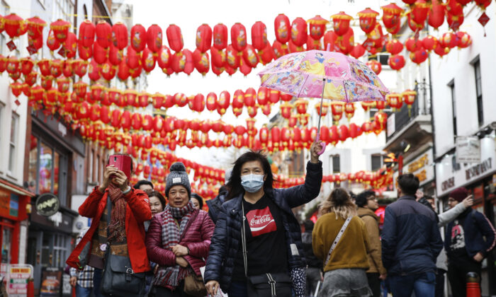 A woman wears a face mask in Chinatown in London on Feb. 2, 2020. (Hollie Adams/Getty Images)