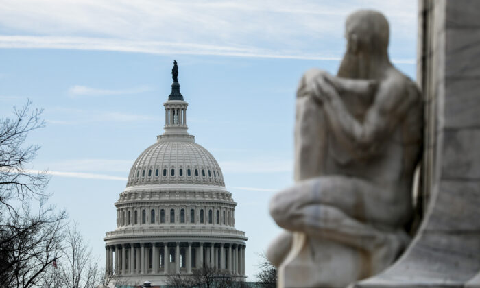 The Christopher Columbus Memorial Fountain overlooks the Capitol in Washington on Jan. 2, 2020. (Samira Bouaou/The Epoch Times)
