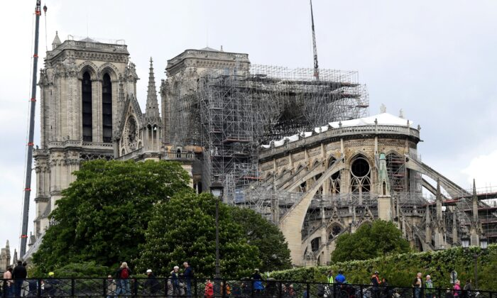 Cranes and scaffolding are seen at the Notre-Dame de Paris on May 10, 2019, as stabilization work continues in preparation for reconstruction to begin after the cathedral was badly damaged by a fire the previous month. (Bertrand Guay/AFP via Getty Images)