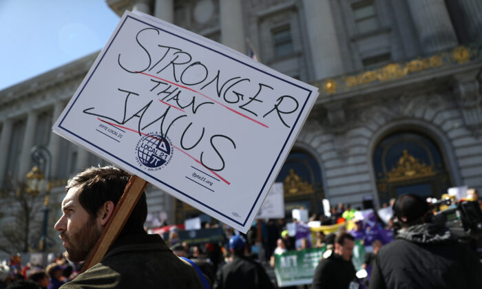 Union members hold signs during a rally outside of San Francisco City Hall on Feb. 26, 2018.  (Justin Sullivan/Getty Images)