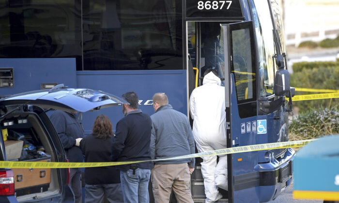 Investigators are seen outside of a Greyhound bus after a passenger was killed on board on Feb. 3, 2020 in Lebec, Calif. (Jayne Kamin-Oncea/AP Photo)