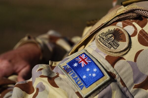 The Australian Army insignia and the Australian flag on military uniform