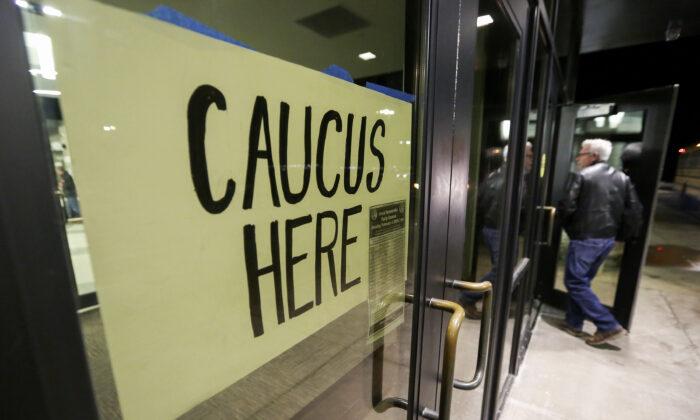 People enter a caucus in Dubuque, Iowa, on Feb. 3, 2020. (Nicki Kohl/Telegraph Herald via AP)