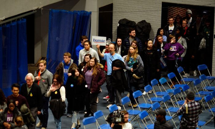 People enter a caucus at Drake University in Des Moines, Iowa, on Feb. 3, 2020. (Eric Thayer/Reuters)