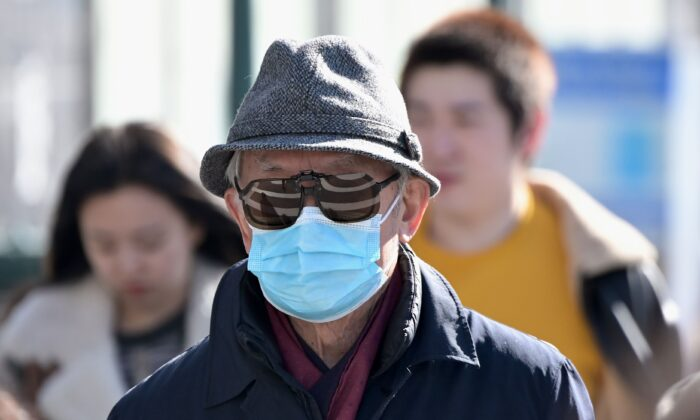 People wear surgical masks in Flushing in the New York City borough of Queens on Feb. 3, 2020. (Johannes Eisele/AFP via Getty Images)